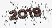 Human crowd forming 2019l on white background. Horizontal  composition with copy space. Directly above. Clipping path is included. 2019 and new year concept.