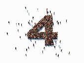 Human crowd forming a big number four on white background. Horizontal  composition with copy space. Clipping path is included. Success concept.