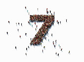 Human crowd forming a big number seven on white background. Horizontal  composition with copy space. Clipping path is included. Success concept.