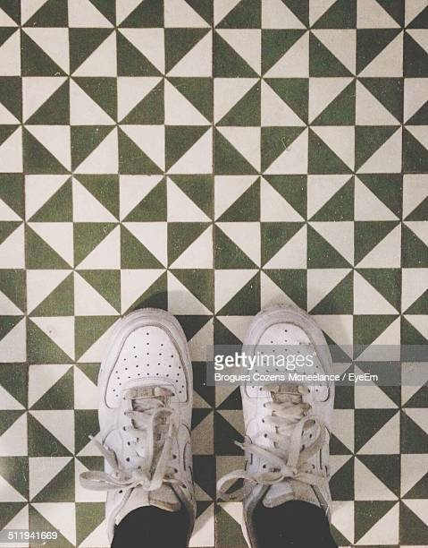Human feet against designed flooring