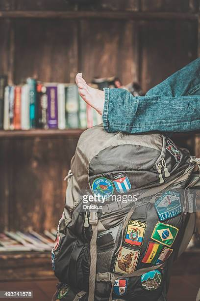 Human Feet on a Backpack Full Of Country Patches