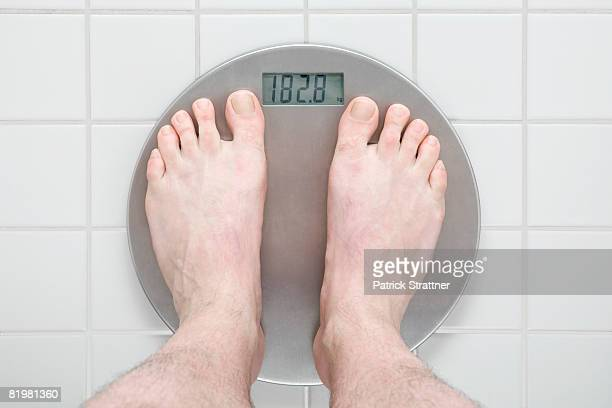 Human feet standing on a scale
