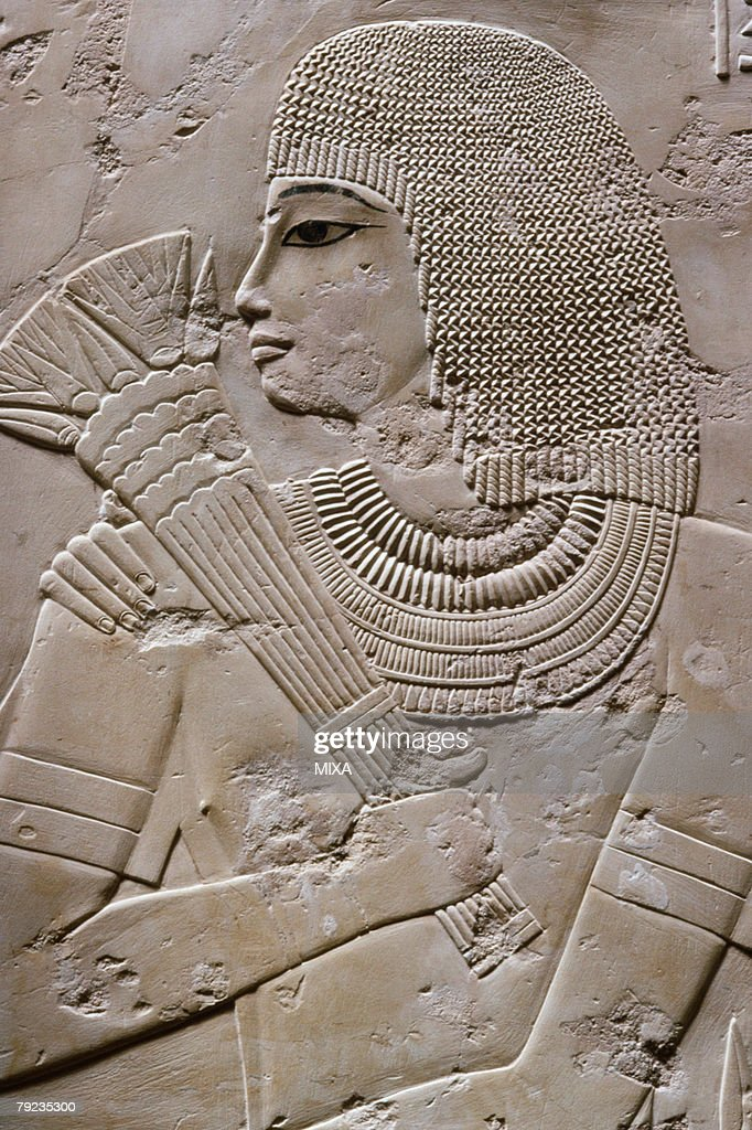 A human figure carved on wall in Luxor, Egypt : Stock Photo