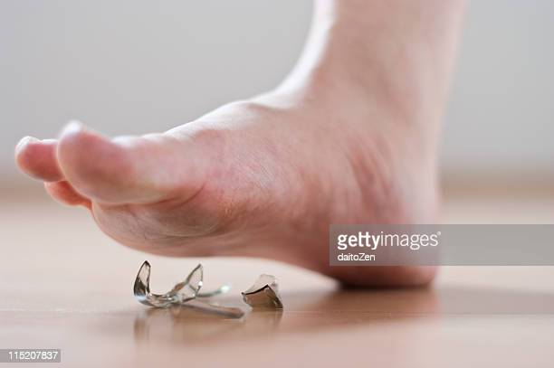 Human foot with broken glass
