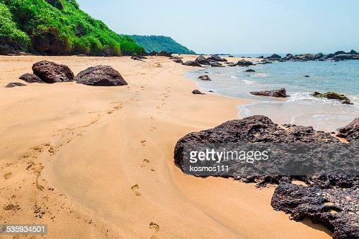 Human footprints on a sandy beach on the island : Stock Photo