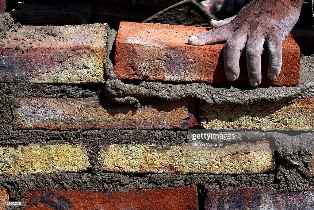 Human hand building brick wall : Stock Photo