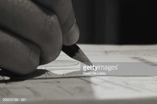 Human hand drawing with pencil : Stock Photo