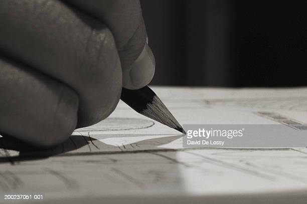 Human hand drawing with pencil