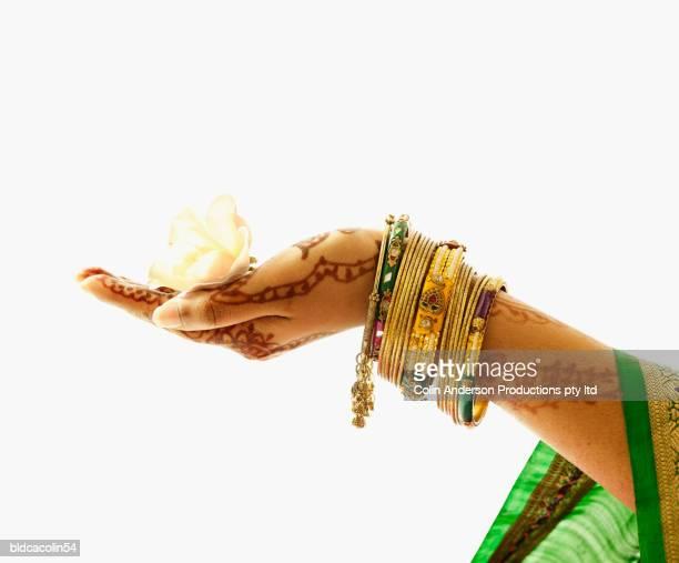 Human hand holding a flower