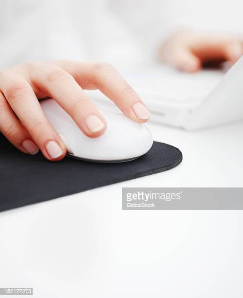 Human hand holding laptop mouse