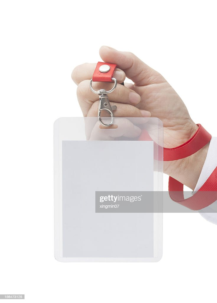 Name tag in hand