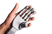 isolated human hand holding robotic hand