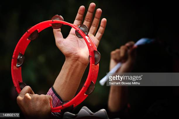Human hand holding tambourine