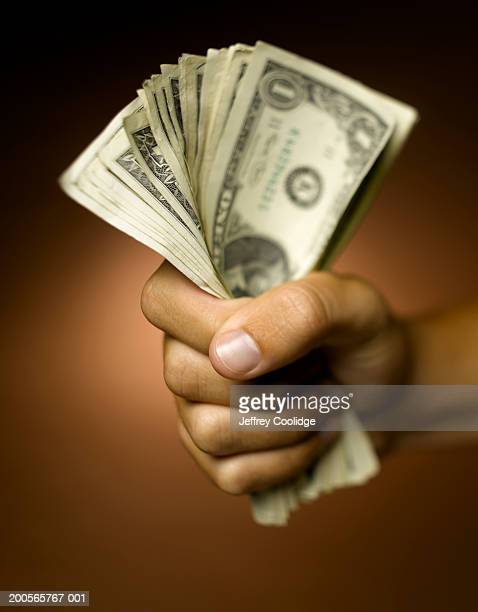 Human hand holding US dollars in hand, close-up