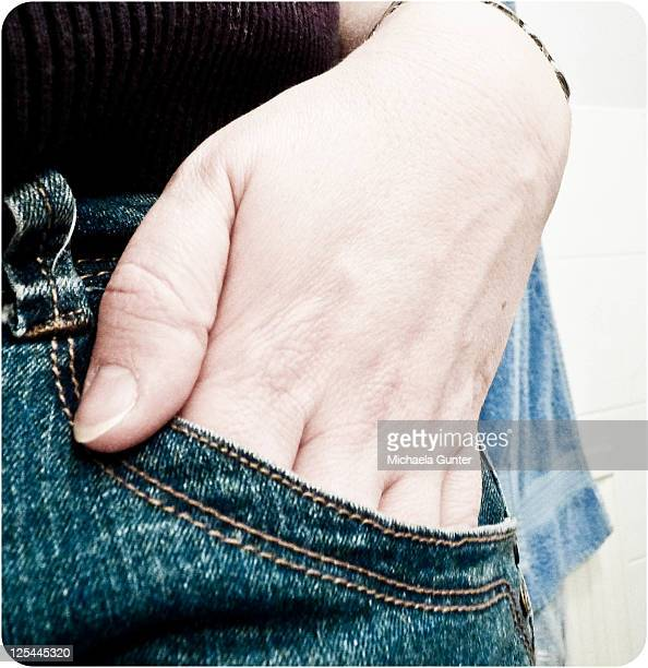 Human hand in pocket