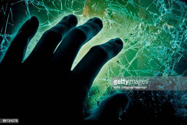 Human hand on a broken glass