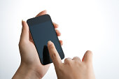 Human hand touching smart phone
