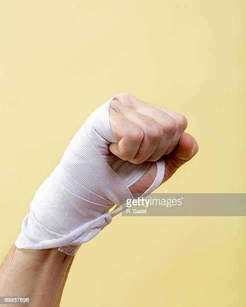 A human hand with a bandage on it