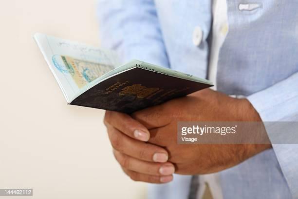 Human hands holding a passport