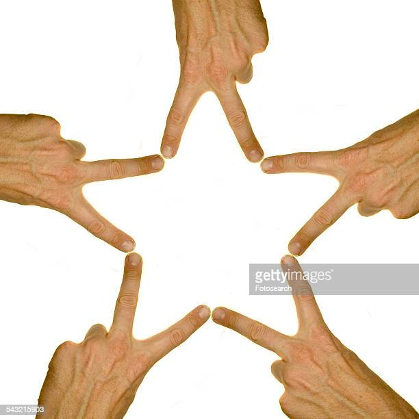 Human hands making a star shape
