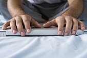 Human hands on a laptop