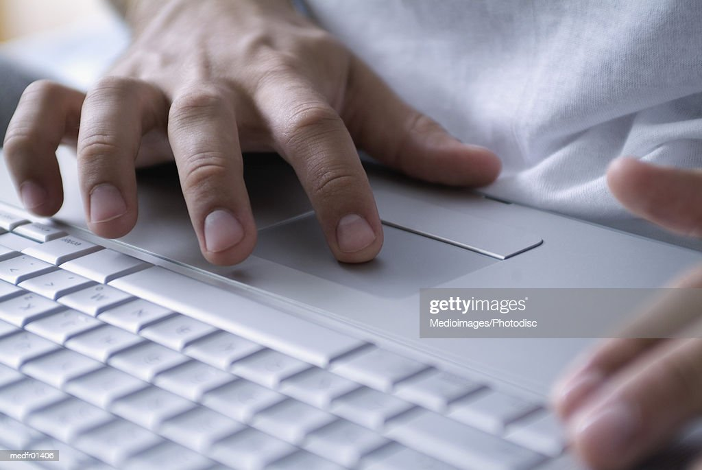 Human Hands operating a Laptop : Stock Photo