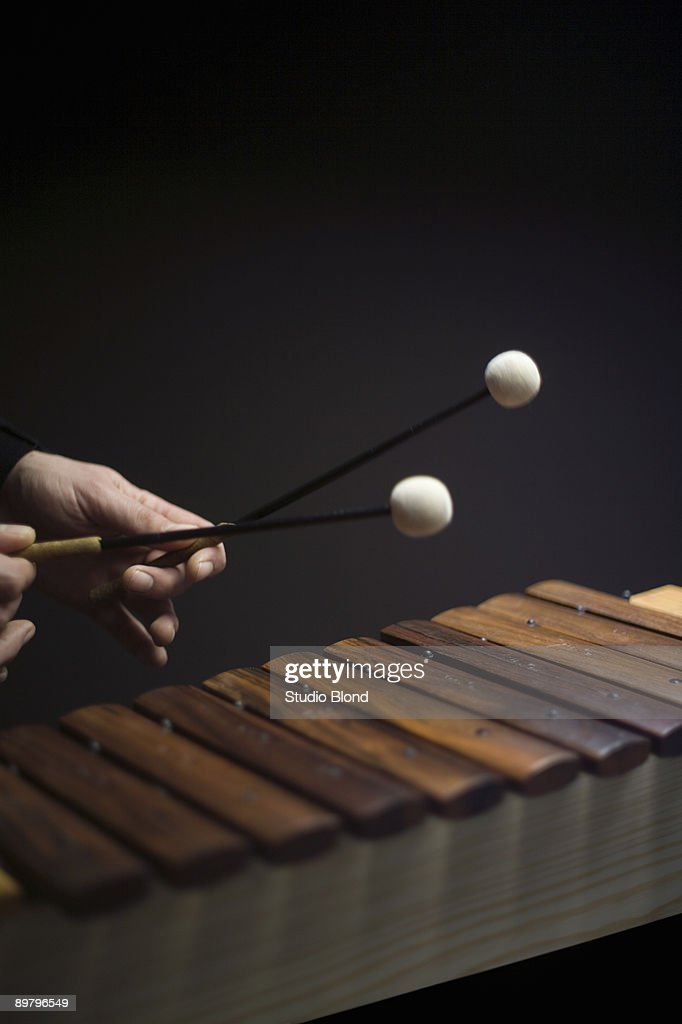 Human hands playing a xylophone
