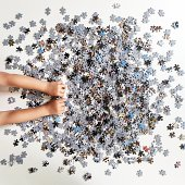 Human hand with jigsaw puzzle pieces