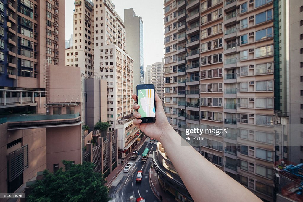 Human hands using smartphone to navigate direction