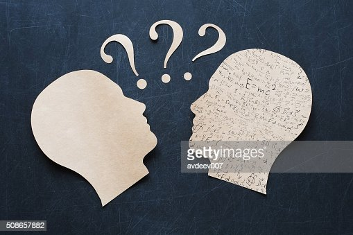 Human Heads with question mark (knowlege transfer) : Stock Photo
