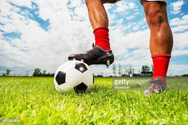 Human leg on a soccer ball.
