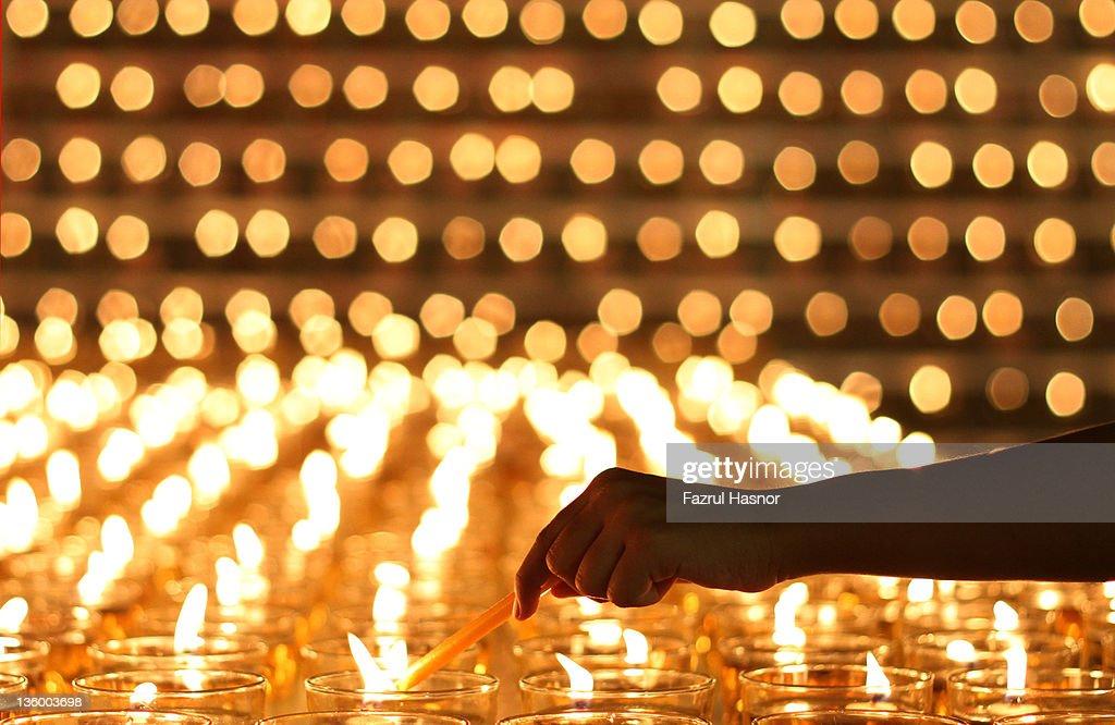 Human lighting candle : Stock Photo