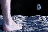 Human naked foot on moon's surface