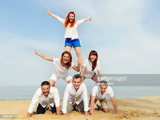 human pyramid on beach