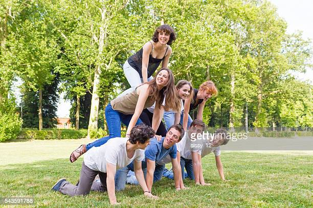human pyramid teenagers in a park