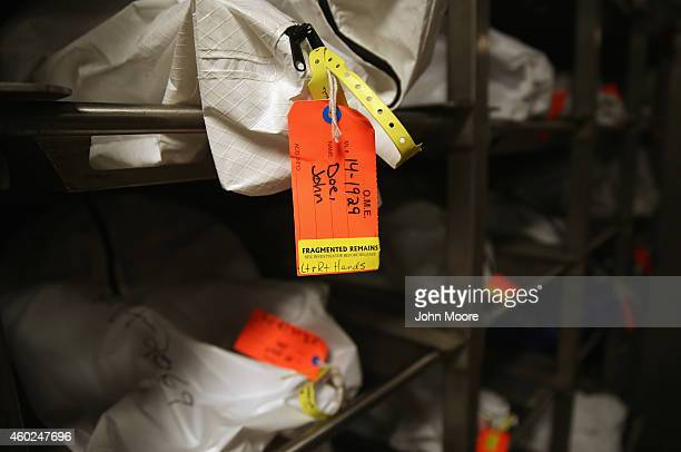 Human remains in body bags lie in the refrigerated morgue of the Pima County Office of the Medical Examiner on December 9 2014 in Tucson Arizona...