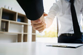 human resource recruiter handshaking with candidate