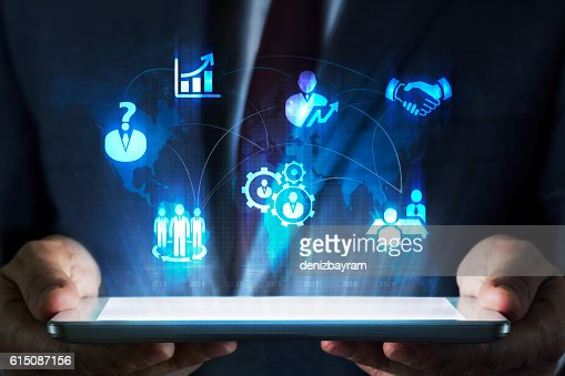 Human resources concept on tablet with hologram : Stock Photo