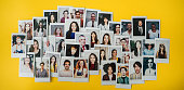 Polaroid photos of different people hanged on the wall.