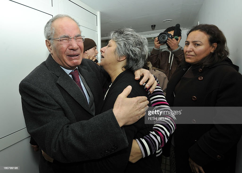 Human rights activist and lawyer Mokhtar Trifi (L) and Basma Khalfaoui Belaid (C), the wife of assassinated Tunisian opposition leader and outspoken government critic Chokri Belaid, mourn over the latter's death after he was shot dead with bullets fired from close range on February 6, 2013, at a clinic in Tunis. President Moncef Marzouki has cancelled his participation in the Organisation of Islamic Cooperation summit in Cairo and is heading back to Tunisia after the murder of opposition leader Chokri Belaid, the presidency said. His assassination comes at a time when Tunisia is witnessing a rise in violence fed by political and social discontent two years after the mass uprising that toppled the former dictator Zine El Abidine Ben Ali.