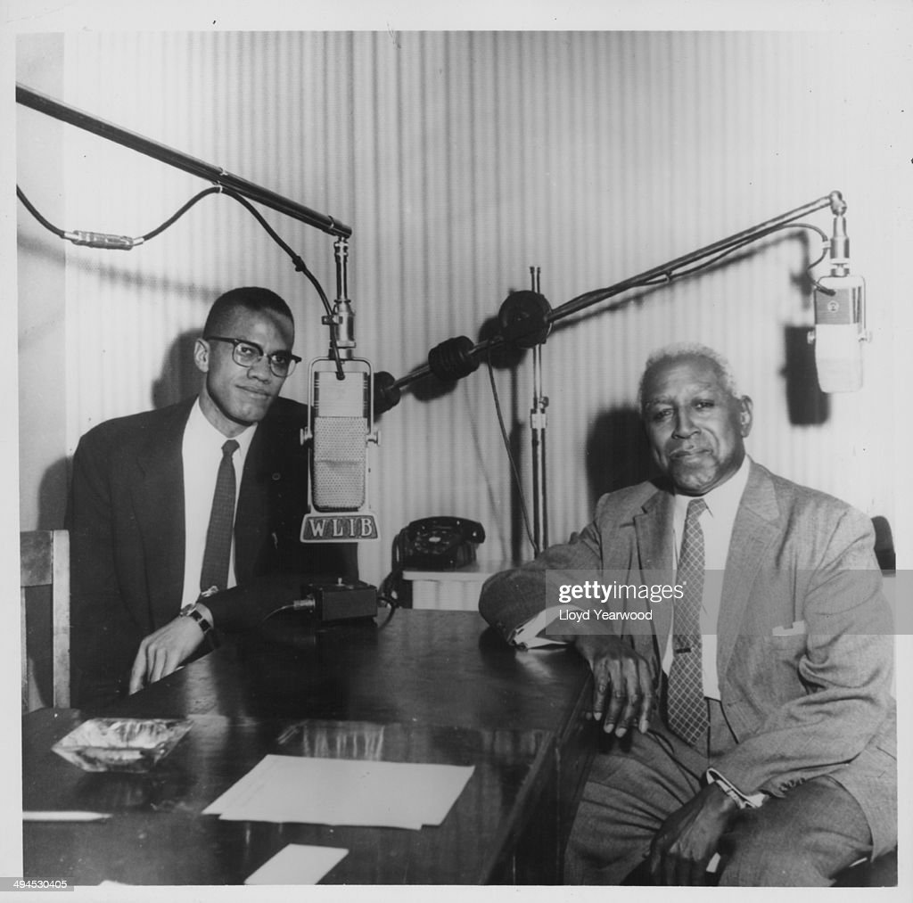 Human rights activist Malcolm X at Harlem Broadcasting Station WLIB expressing his views on the radio with editor George S Schuyler circa 19601965