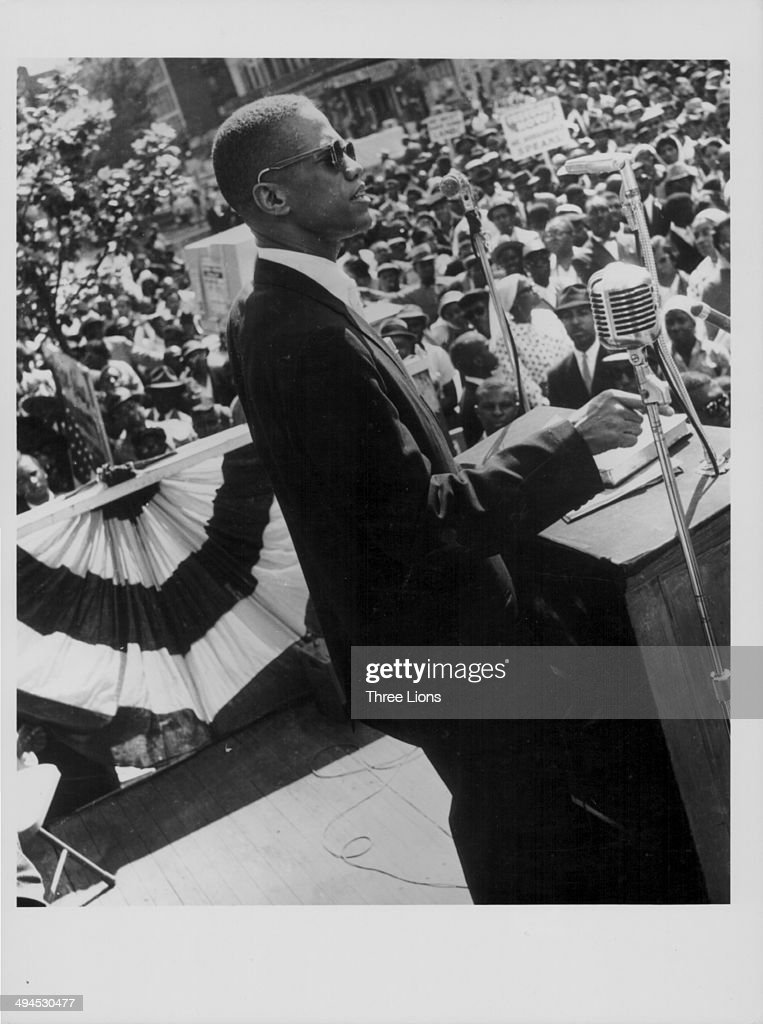 Human rights activist <a gi-track='captionPersonalityLinkClicked' href=/galleries/search?phrase=Malcolm+X&family=editorial&specificpeople=70045 ng-click='$event.stopPropagation()'>Malcolm X</a> speaking on stage at a Muslim meeting in Harlem, New York, circa 1960-1965.