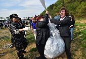 US human rights activist Suzanne Scholte and South Korean activists release a balloon carrying antiPyongyang leaflets at a field near the...