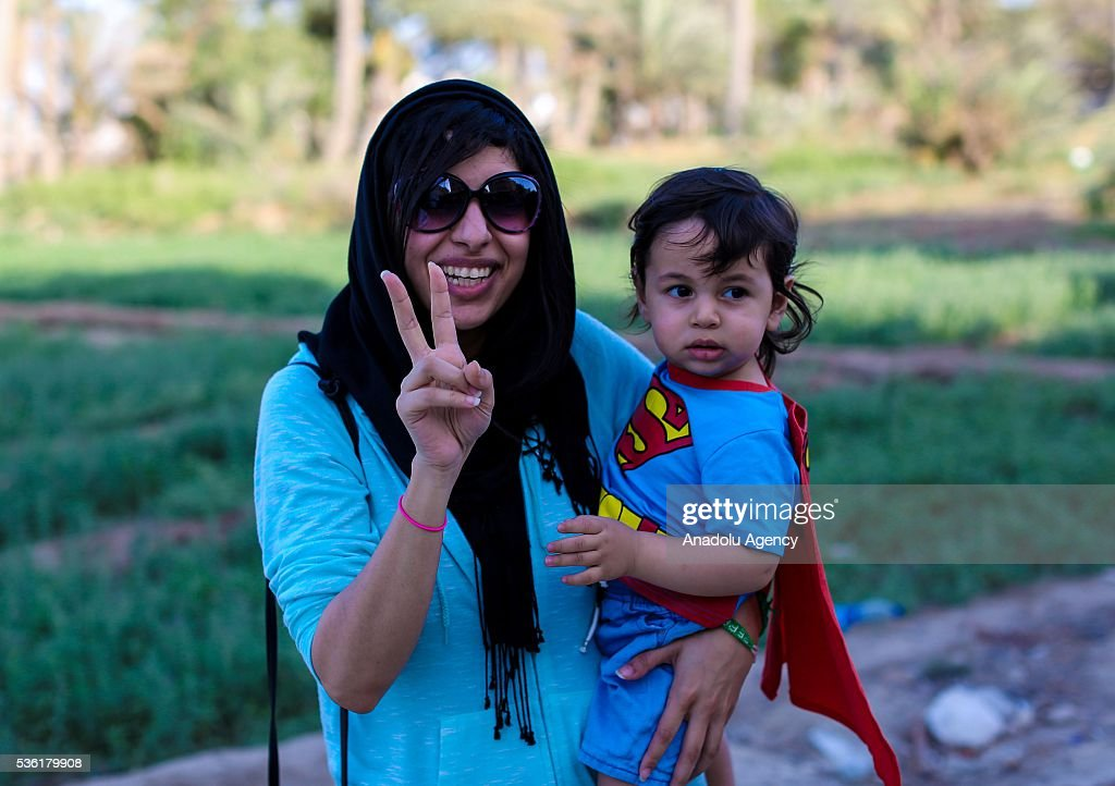 Human rights activist Zainab al-Khawaja and her infant son pose to the media after they released from prison in Manama, Bahrain on May 31, 2016. Al-Khawaja has been sentenced 3 years to prison and get fined 8,000 US Dollars due to the claims on insulting King of Bahrain. A court in Bahrain has ordered the release of Al-Khawaja, considering the possibility of negative effects of prison on her son's psychology.