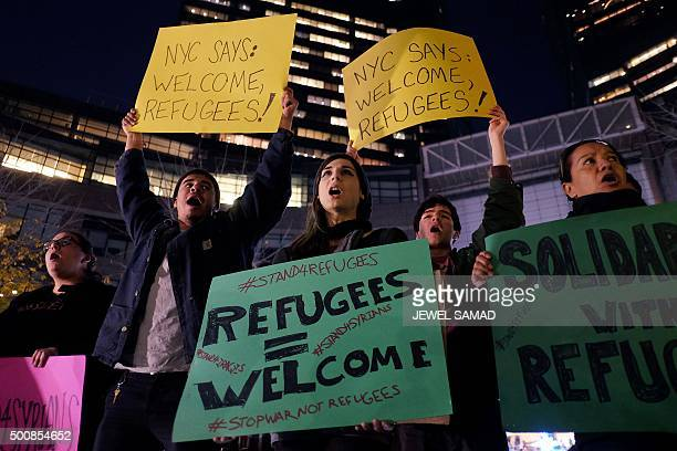 Human rights activists and people from the Muslim community display placards during a demonstration in New York on December 10 in solidarity for...