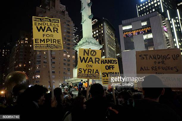 TOPSHOT Human rights activists and people from the Muslim community display placards during a demonstration in New York on December 10 in solidarity...