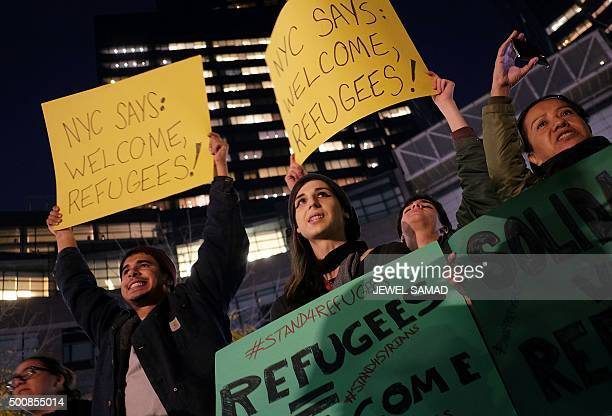 Human rights activists and people from the Muslim community display placards during a demonstration in New York on December 10 2015 in solidarity for...