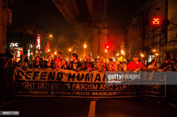 Human rights activists chant and hold placards as they head towards Mendiola Peace Arch in Manila Philippines on 10 December 2017 Thousands of human...