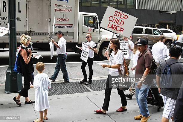 Human rights activists protesting child labor practices in Uzbekistan congregate outside the Guli Spring 2012 fashion show at Cipriani 42nd Street on...