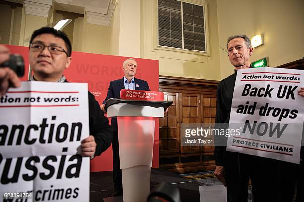 Human rights campaigner Peter Tatchell stages a protest calling for aid drops in Syria as Labour Leader Jeremy Corbyn makes a speech at the Methodist...